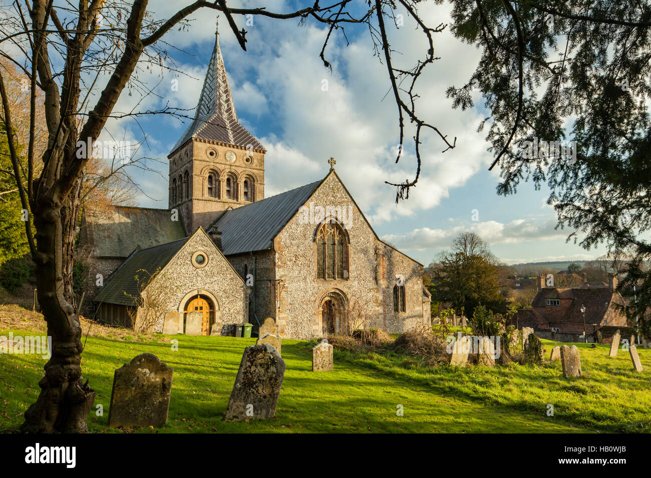 Autumn at All Saints church in East Meon, Hampshire, England. South Downs National Park. - Stock Image