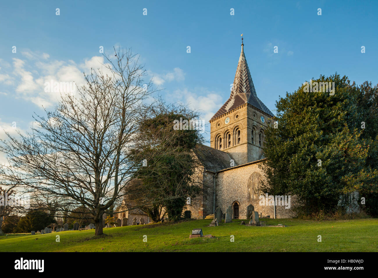 Autumn at All Saints church in East Meon, Hampshire, England. - Stock Image