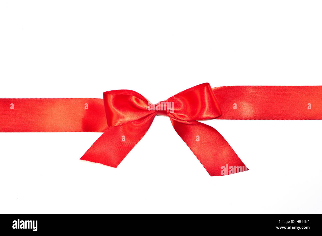 Red bow ribbon with tails isolated on white background Stock Photo