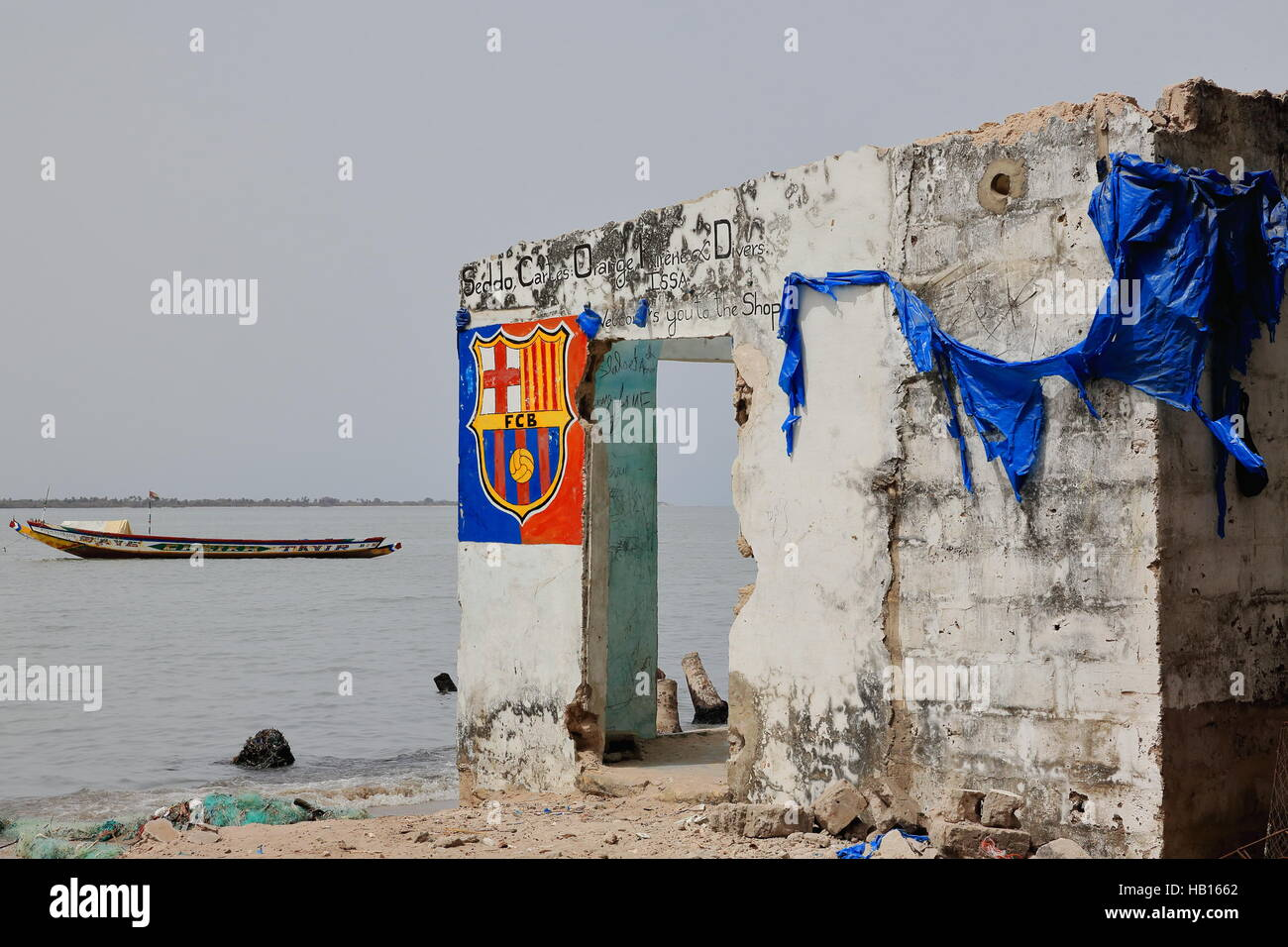 Diogue island, Senegal-April 15, 2014: The ruins of a deserted shop on the shore facing the mouth of the Casamance - Stock Image