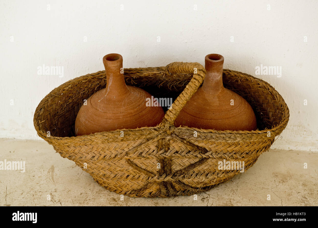 basket with clay mugs - Stock Image