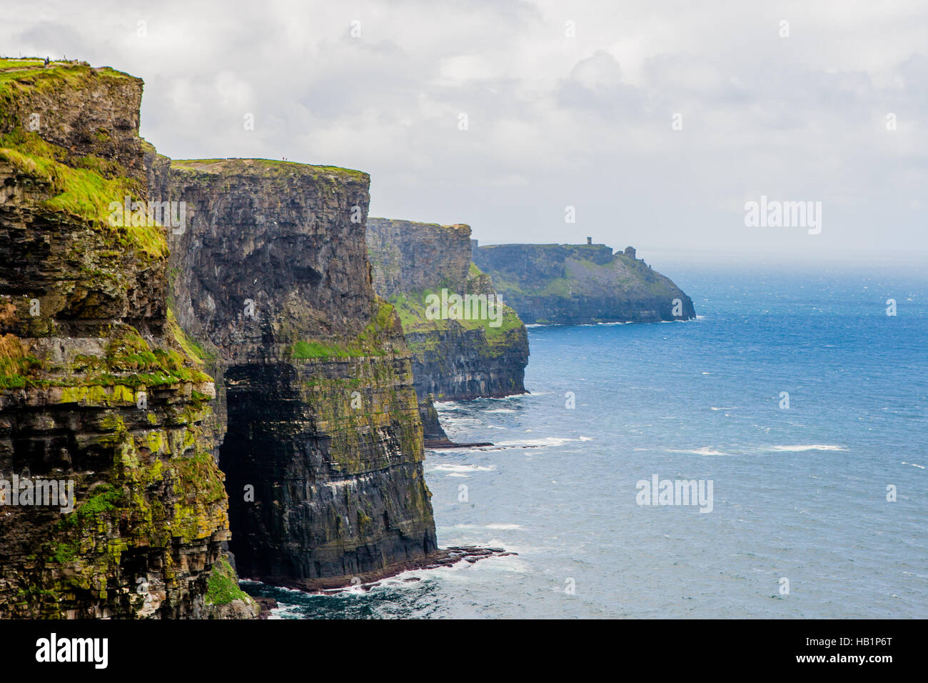 Cliffs of Moher, Burren region, County Clare, Ireland - August 23, 2010: Cliffs of Moher. They rise 120 metres above - Stock Image