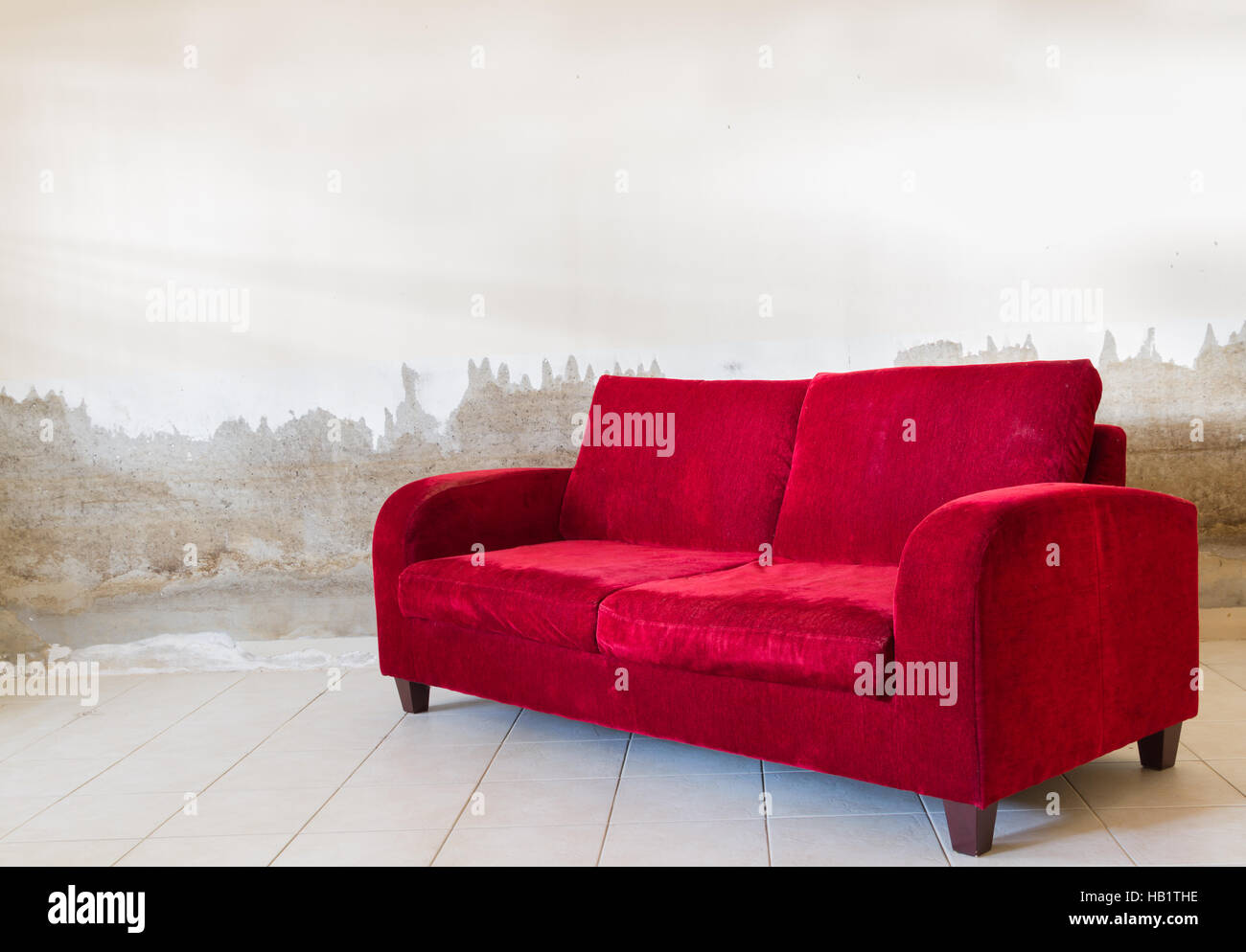 velvet wall against panelling red vintage pin sofa maxalto black couch