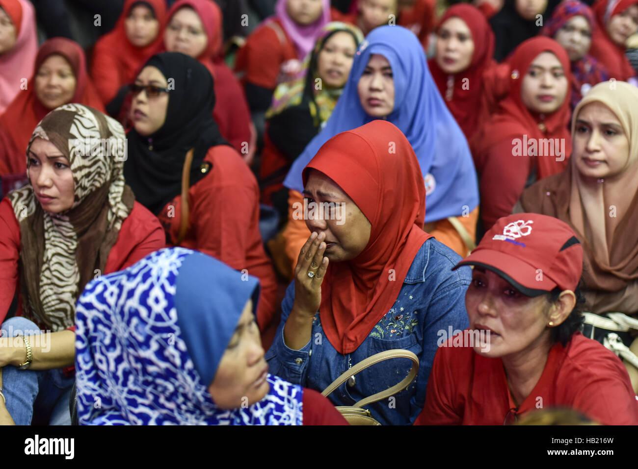 Kuala Lumpur, MALAYSIA  4th Dec, 2016  Malaysian muslims cry