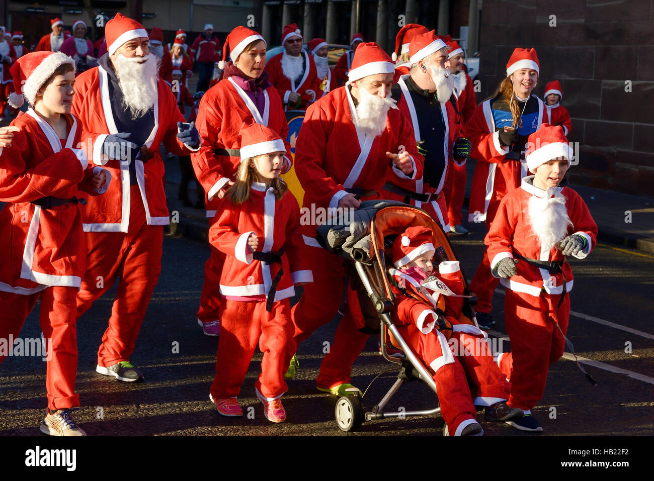 Chester, UK. 4th December 2016. The annual charity santa dash through the city centre streets. Credit: Andrew Paterson/ - Stock Image
