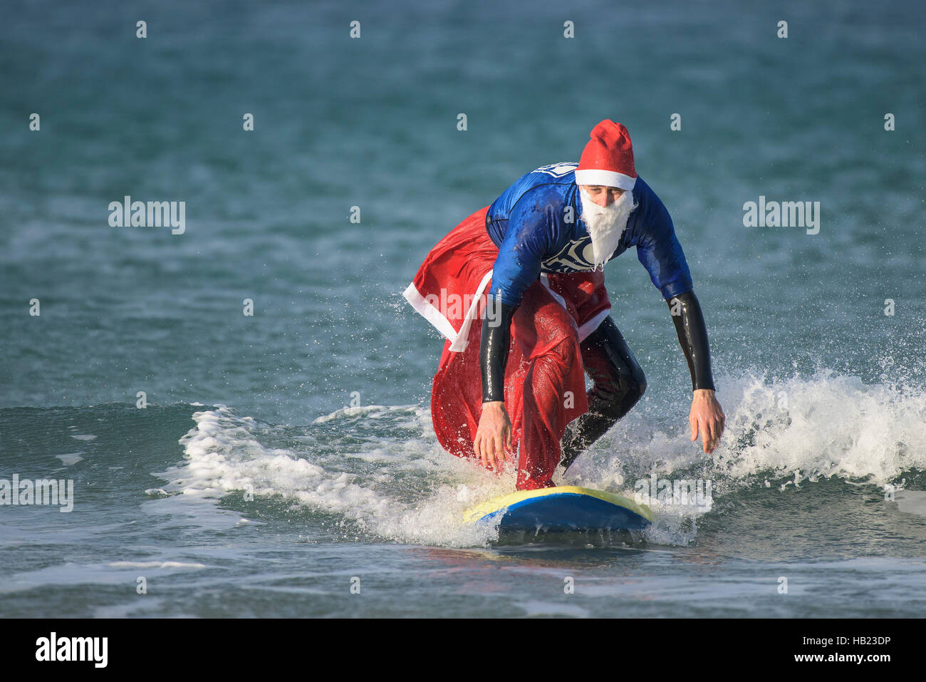Newquay, UK. 04th Dec, 2016. Fistral Beach; Newquay, Cornwall. 4th December, 2016. A bedraggled Tom Butler wins - Stock Image