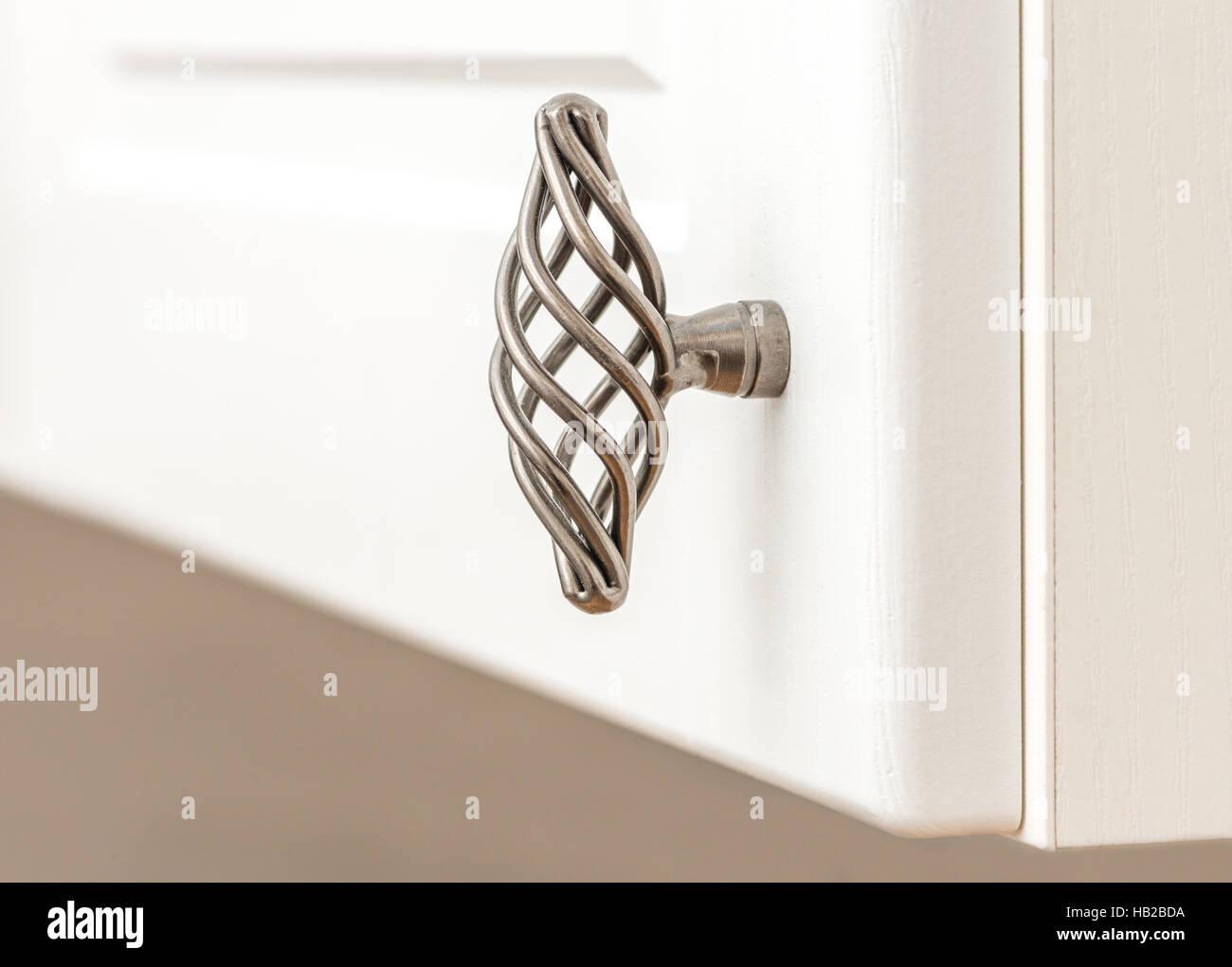kitchen cupboard handle on door - Stock Image