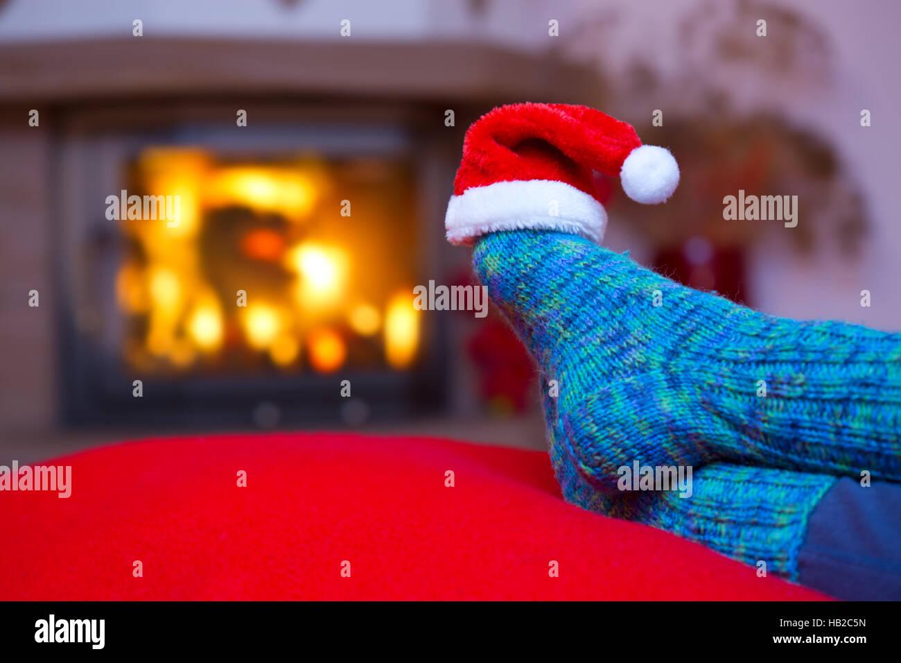 Feet In Woollen Blue Socks And Santa Hat Stock Photo 127287265