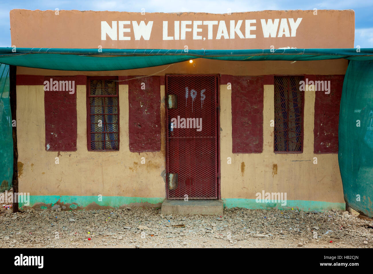 Colorful house facade in Opuwo Town, Namibia - Stock Image