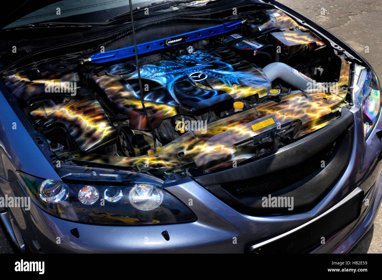 Mazda car with artistic decorative pattern painted on its engine - Stock Image