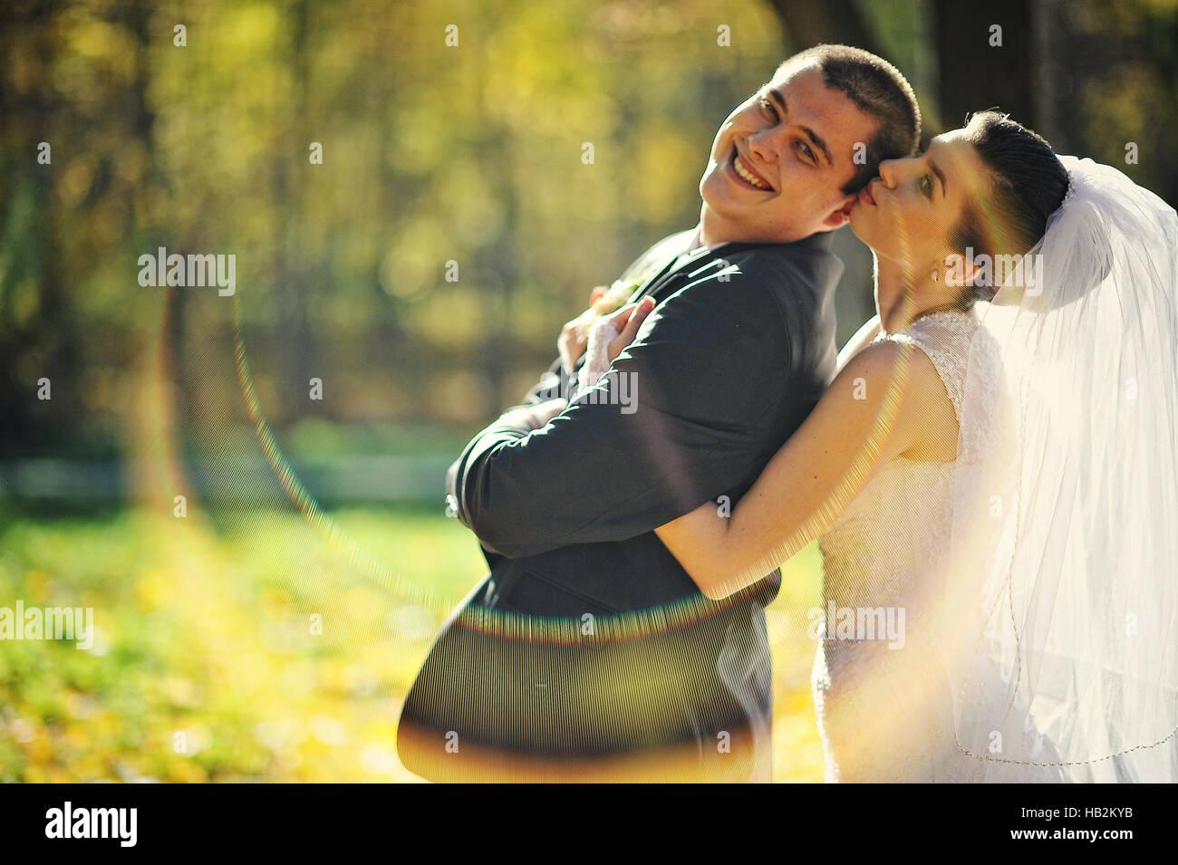 Glorious newlyweds at autumn sunshine - Stock Image