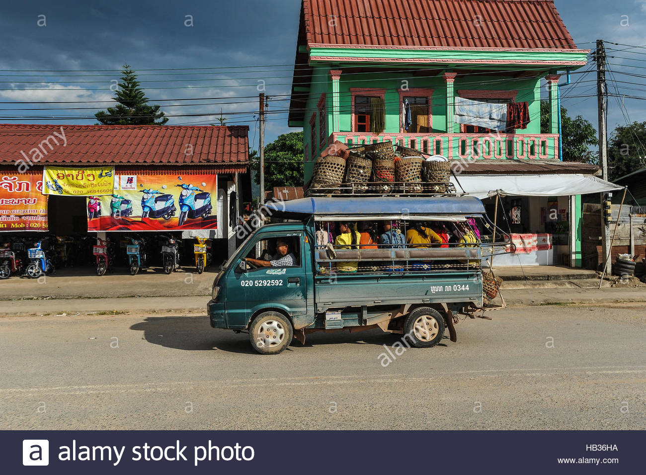 Street of Luang Nam Tha and public transport, Lao PDR - Stock Image