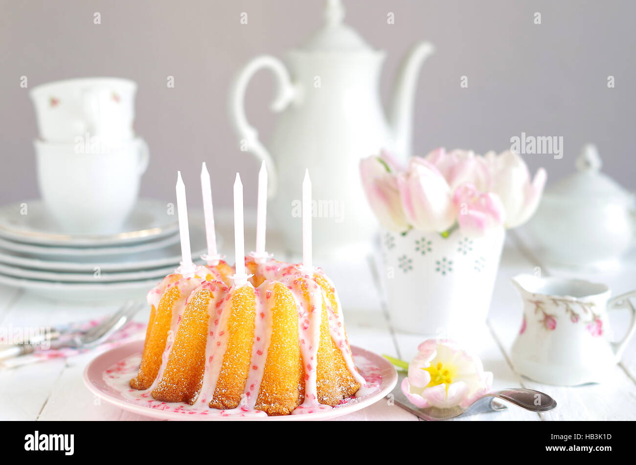coffee table with birthday cake - Stock Image