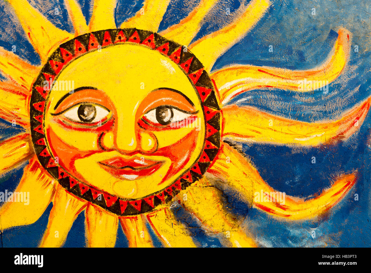 Colored bright sun mural painted on wall in Santa Marta, Colombia ...