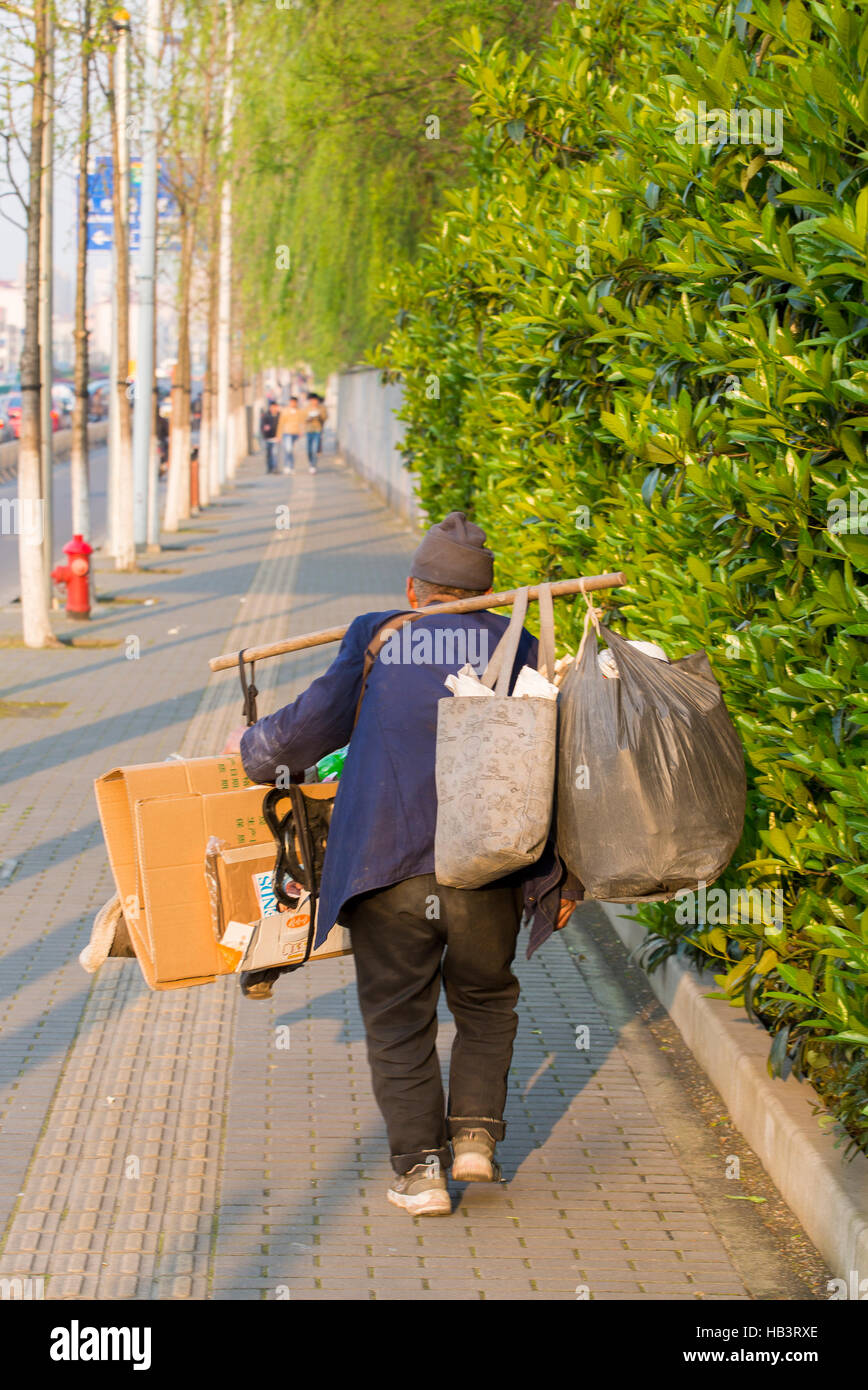 Old Man Carrying Dirty Bags And Cardboards In Shanghai China Stock Photo Alamy