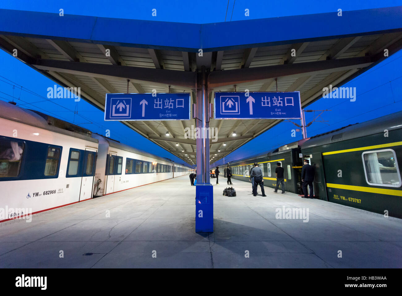 People boarding at a train station early evening in Tibet - Stock Image