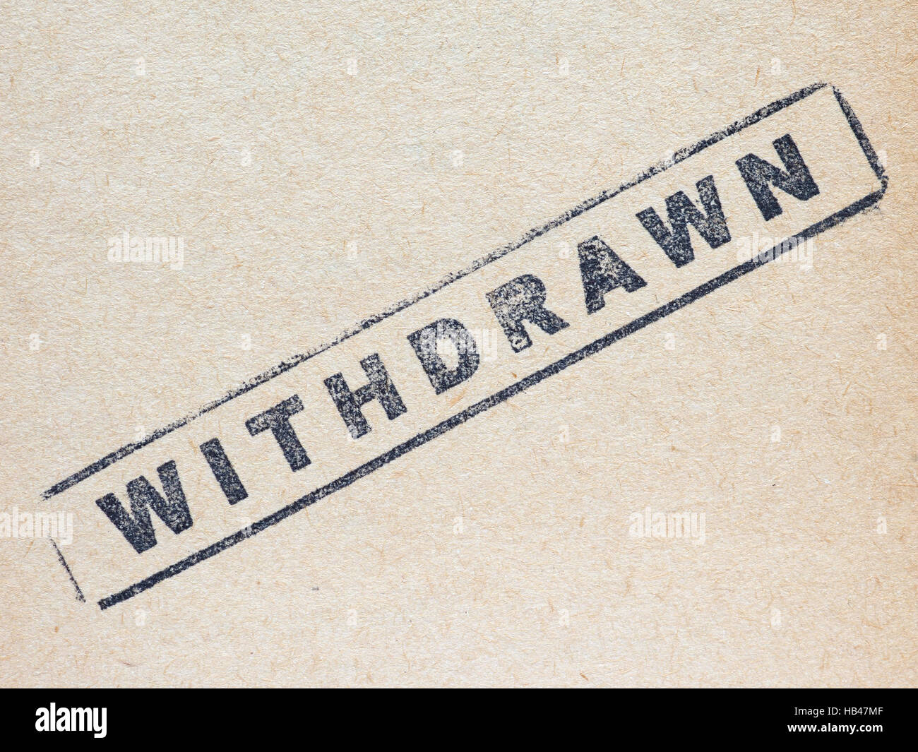 Withdrawn stamp on paper - Stock Image