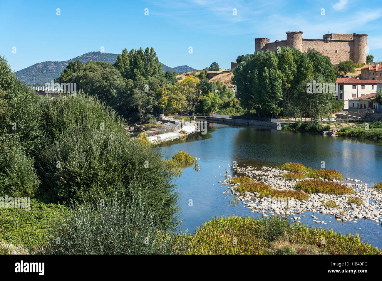 Looking across the River Tormes with the castle in the background, El Barco De Avila, Avila Province, Spain. Stock Photo