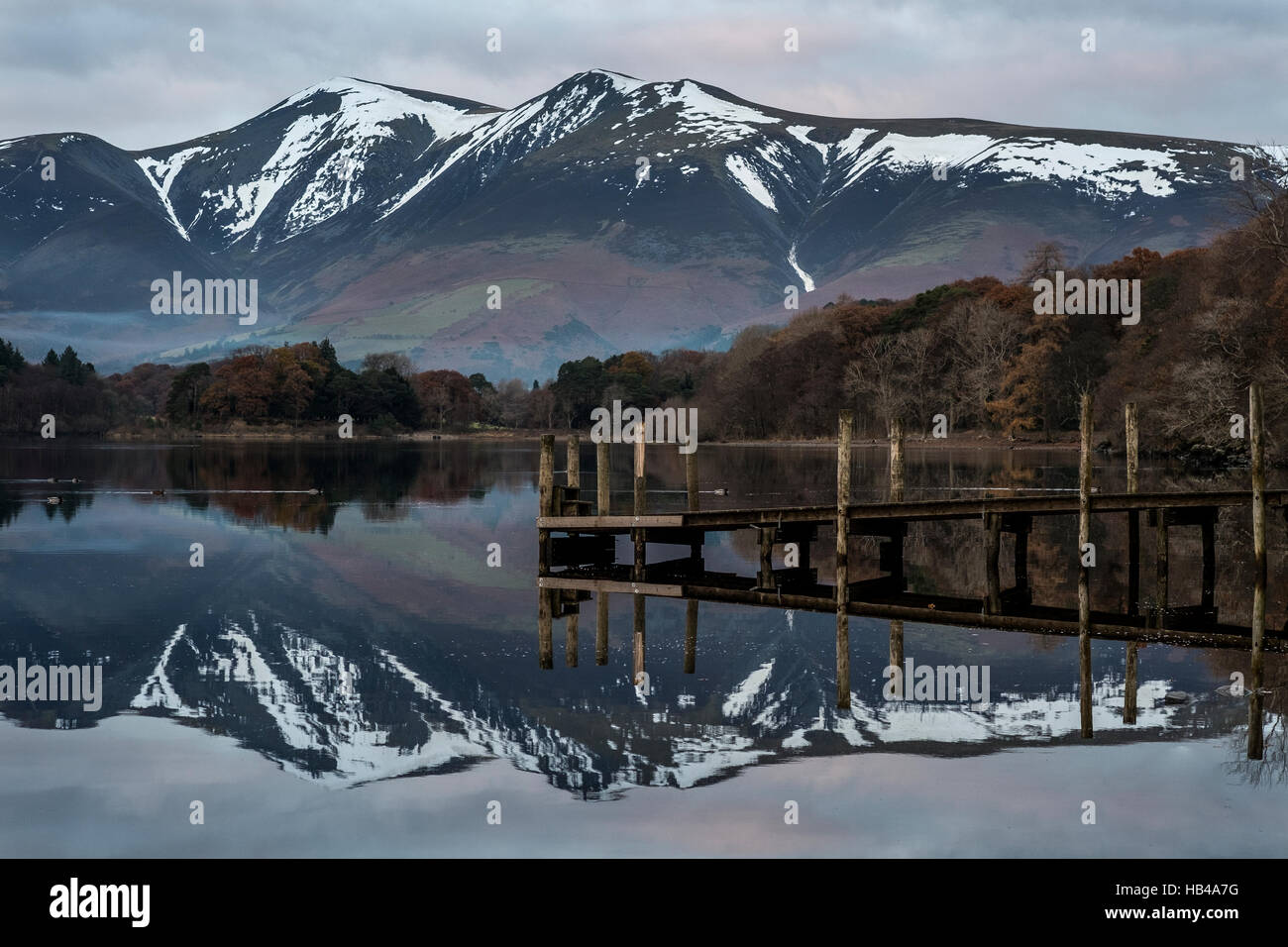 Dusk on Derwent Water in The Lake District with Skiddaw towering high above. - Stock Image