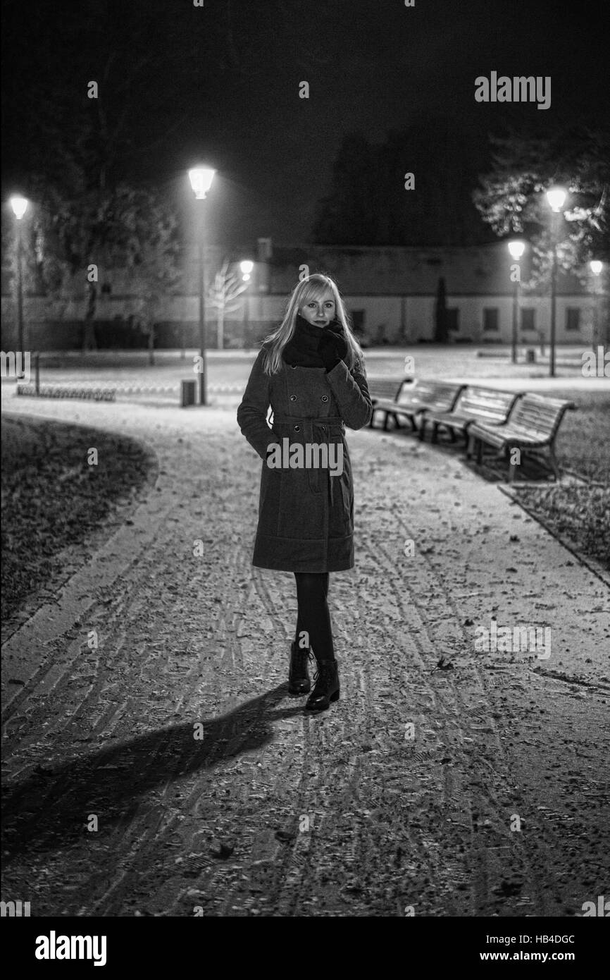 Woman in the park at night - Stock Image