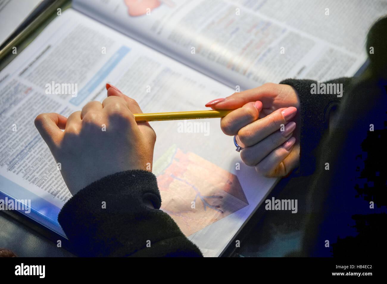 Hands  studying anatomy - Stock Image