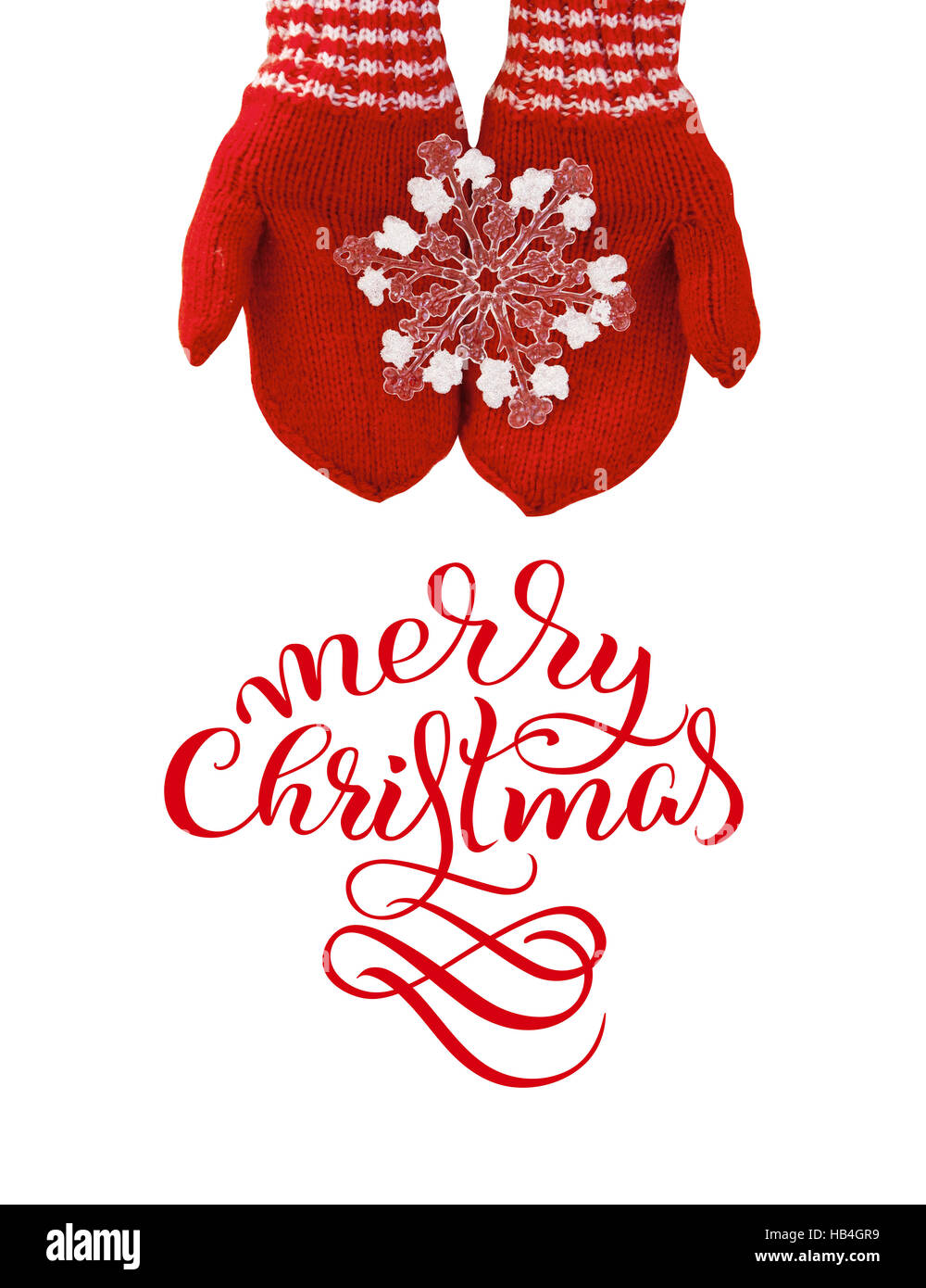 woman hands in red mittens hold a toy snowflake with text Merry Christmas. Lettering calligraphy - Stock Image