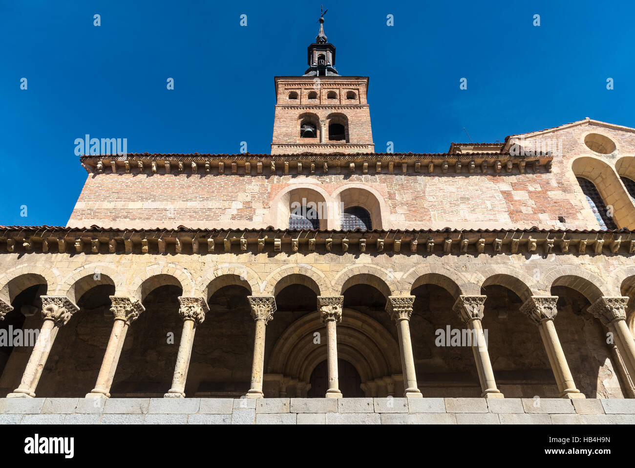 The romanesque Church of San Martin with its mudejar bellfry, in the Plaza Medina del Campo, Segovia, Spain Stock Photo