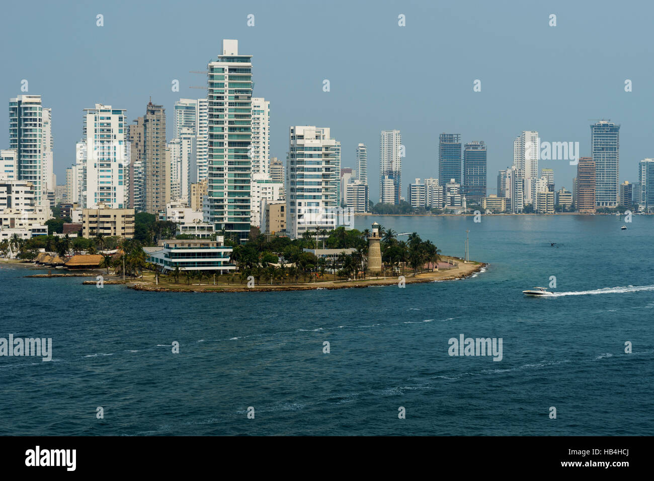 Hi-rise buildings of El Laguito district in the foreground and cityscape seen from seaward. Cartagena, Colombia - Stock Image