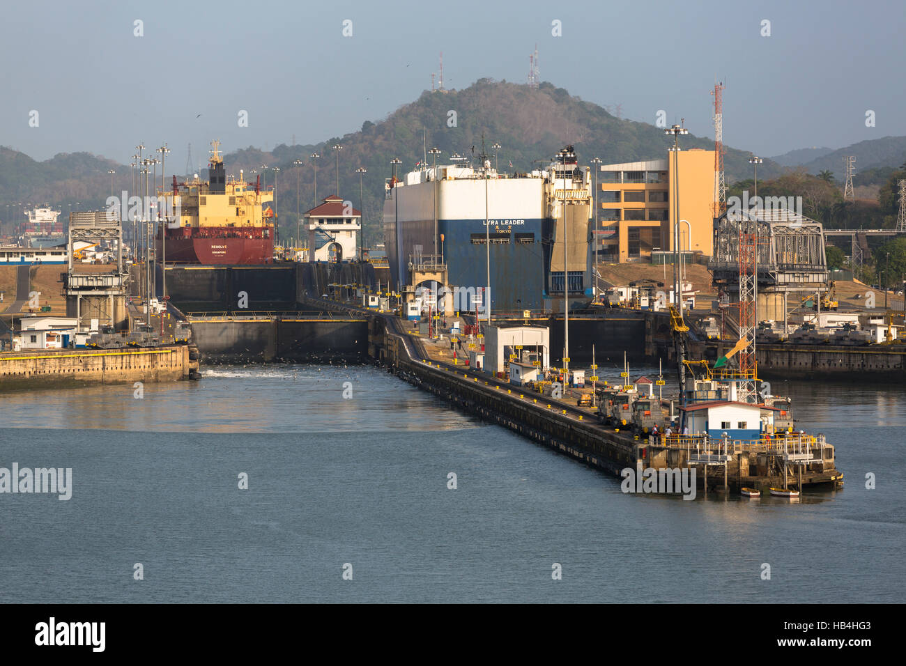 Cargo ships heading in to the Panama Canal from the Miraflores Lock on the Pacific Ocean side - Stock Image