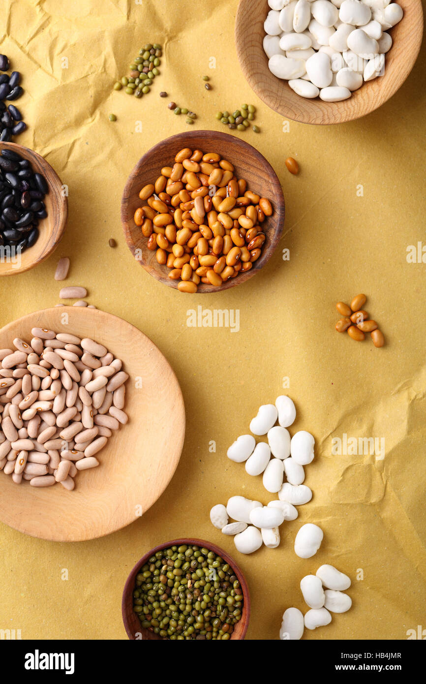 Raw bean and mung on small plates, food background - Stock Image