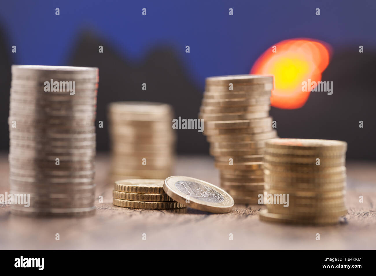 stacked coins twilight - Stock Image
