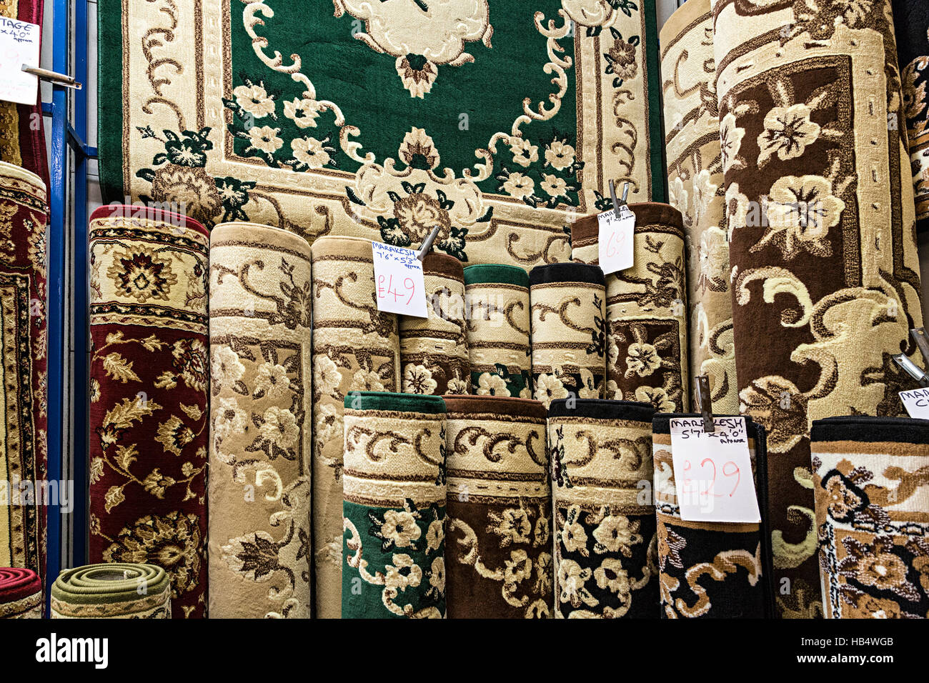 Rugs for sale in shop, Hereford, England, UK - Stock Image