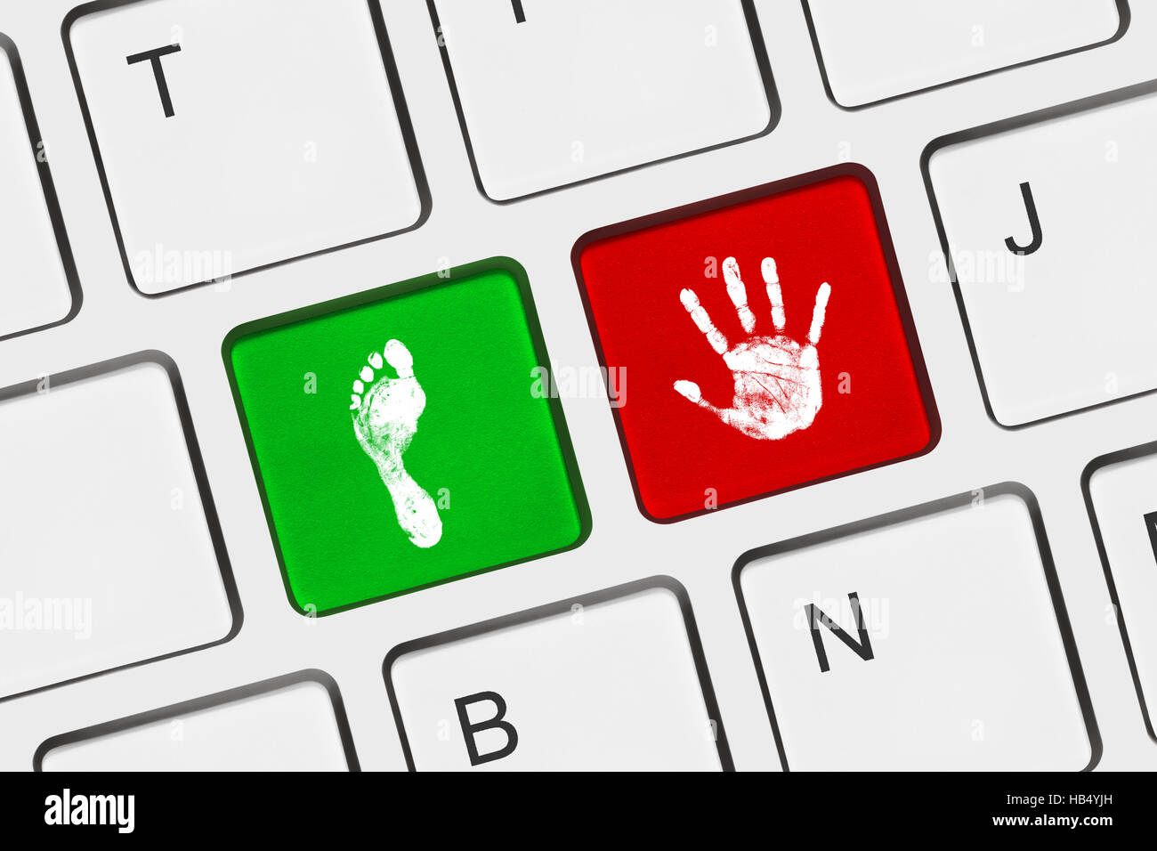 printout of hand and foot on computer keys stock photo 127343289