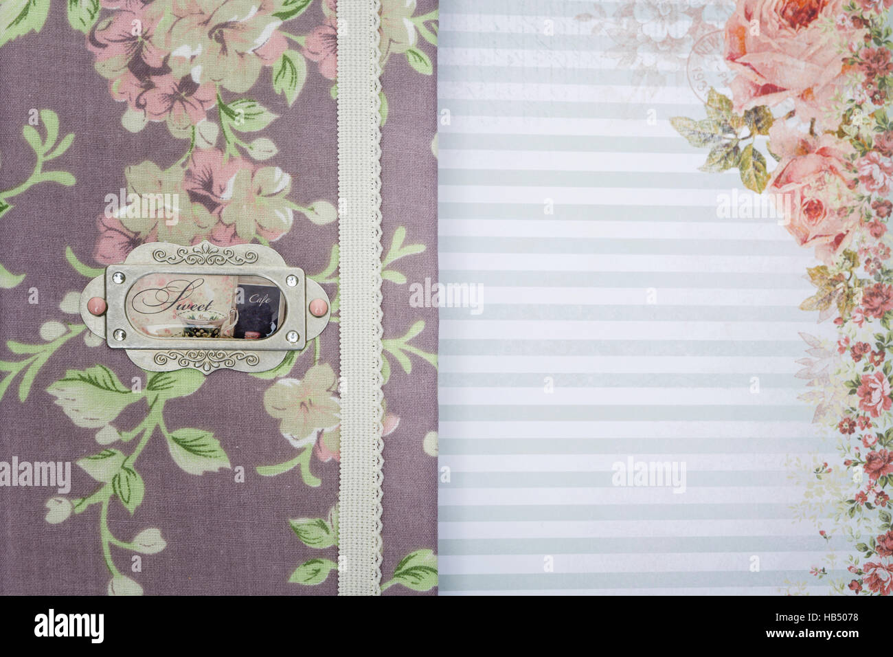 Scrapbooking holder for travel documents on floral paper - Stock Image