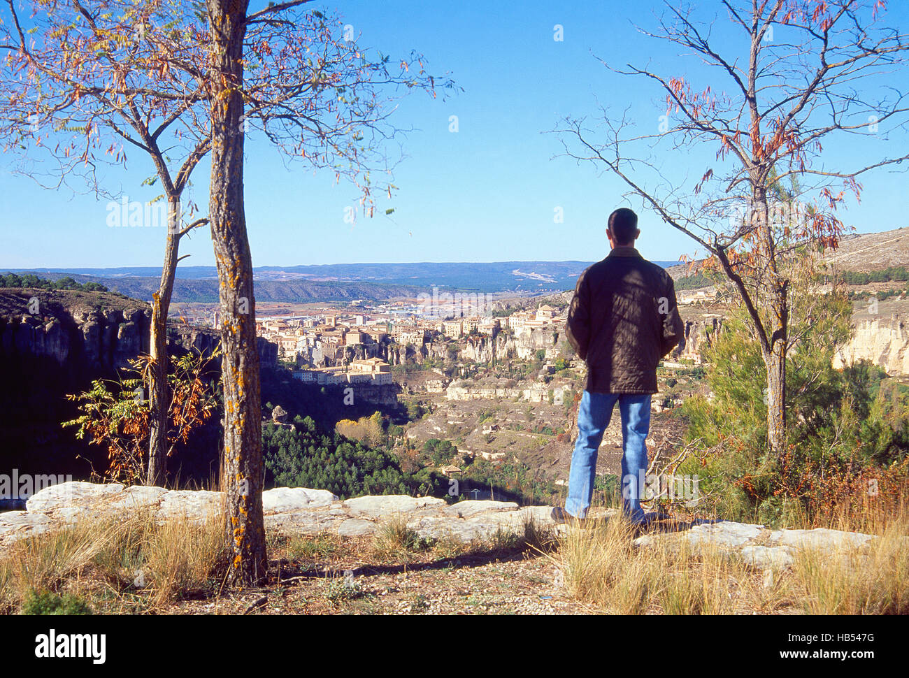 Man at the viewpoint, looking at the city. Cuenca, Spain. - Stock Image