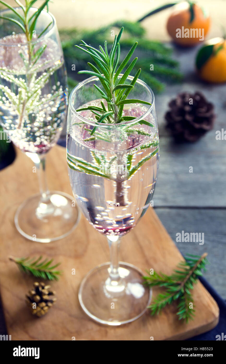 Mimosa festive drink for Christmas - champagne cocktail with rosemary for Christmas party - Stock Image