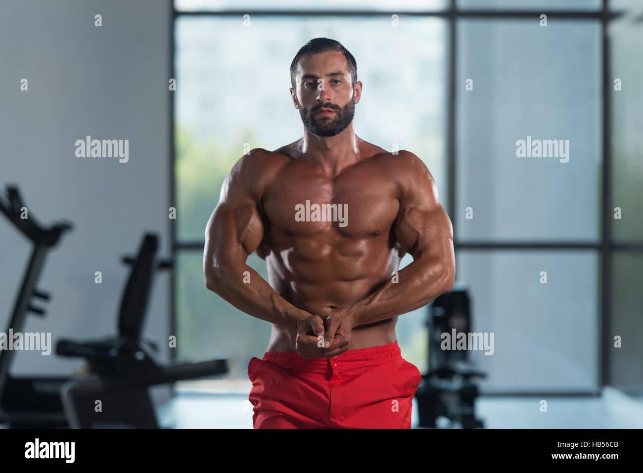 Man Showing Abdominal Muscle — Stock Photo © ibrak #155051334
