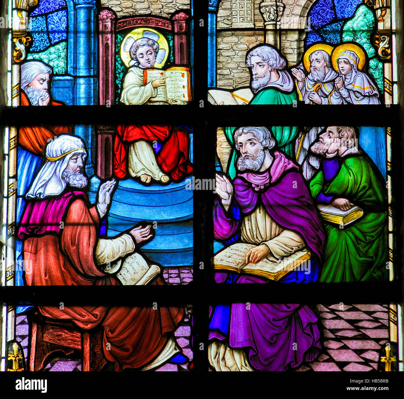 The Finding in the Temple, also called Christ among the Doctors, on a stained glass in Werchter, Belgium. - Stock Image