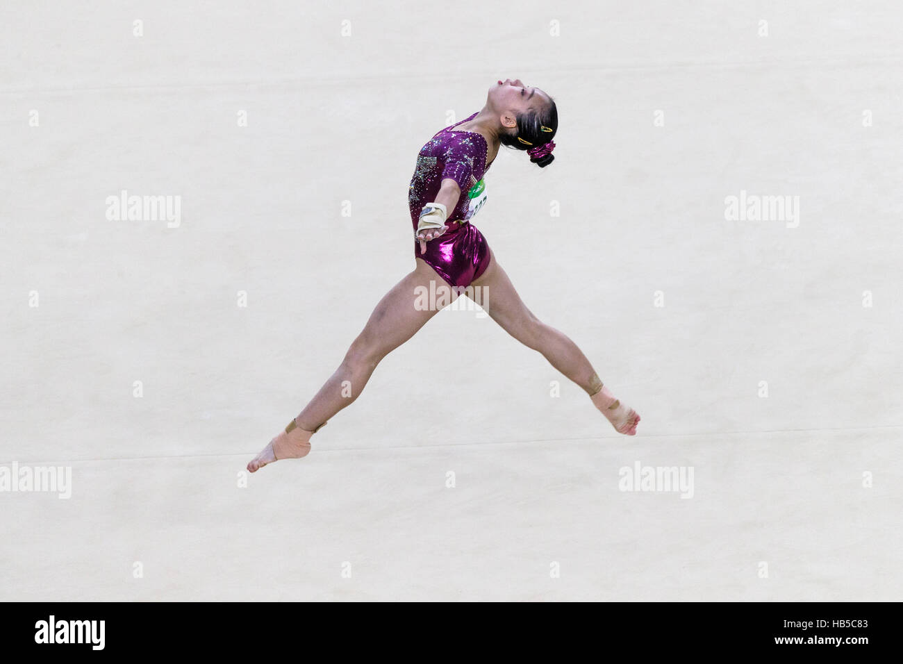 Rio de Janeiro, Brazil. 9 August 2016.  Chunsong Shang (CHN) performs the floor exercise dring team competition - Stock Image