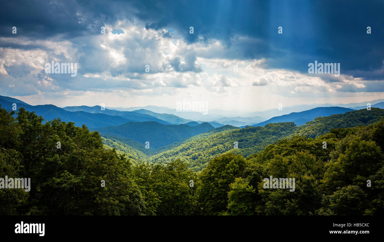 Sunbeams and storm clouds in the Appalachian Mountains along Blue Ridge Parkway in Asheville, North Carolina - Stock Image