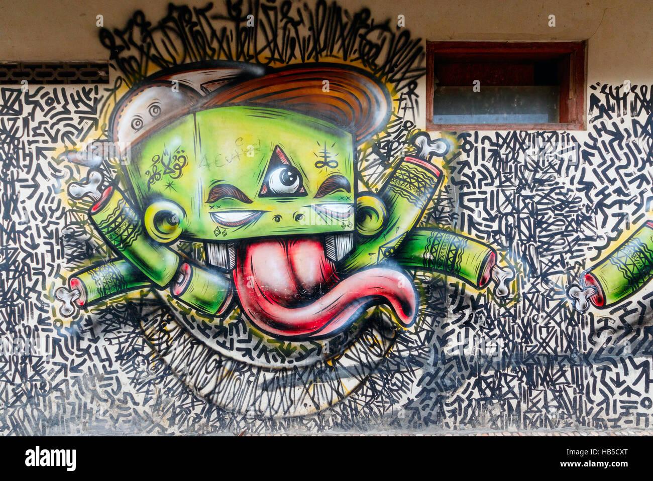 Graffiti in a poor neighbourhood in yogyakarta graffiti in yogyakarta often has a political message java indonesia
