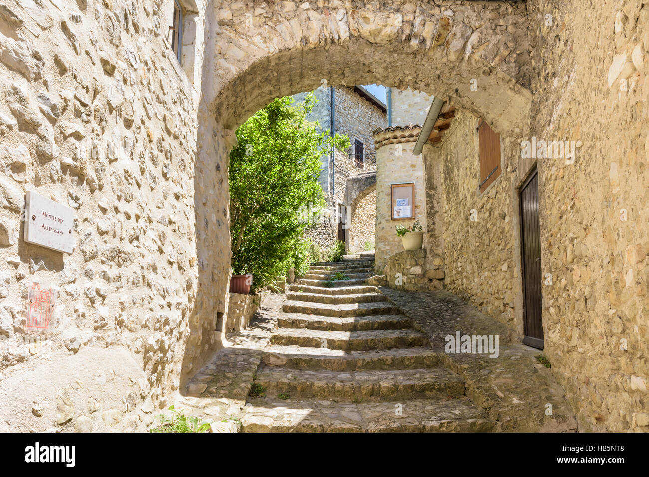 Reinforcing buttress arch in the medieval village of Mirmande, Drôme, France Stock Photo