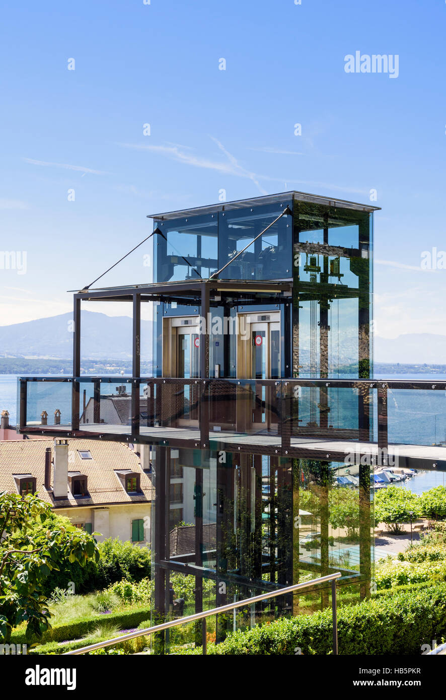 Panoramic glass and steel outdoor elevator leading to an elevated walkway above the town of  Nyon, Vaud, Switzerland - Stock Image