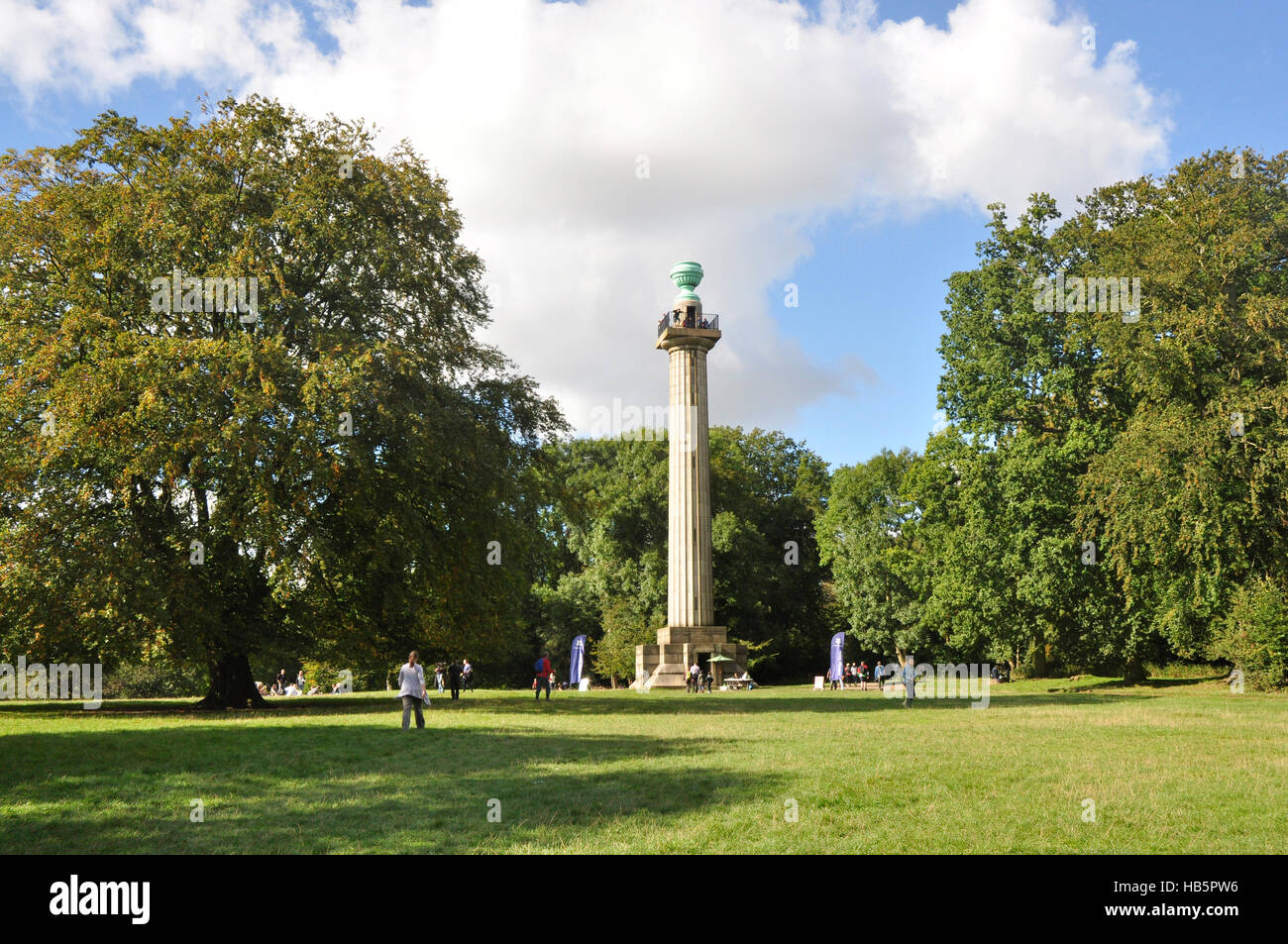 Chiltern Hills - Ashridge - an open day at the Bridgewater monument - framed by early autumn trees - sunlight and - Stock Image
