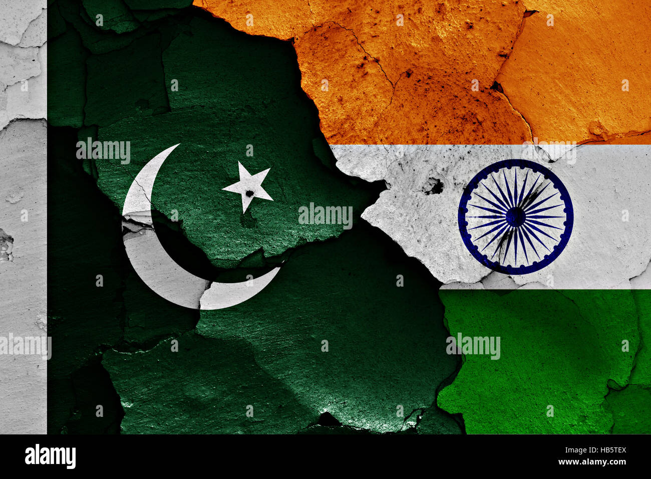 flags of Pakistan and India painted on cracked wall - Stock Image
