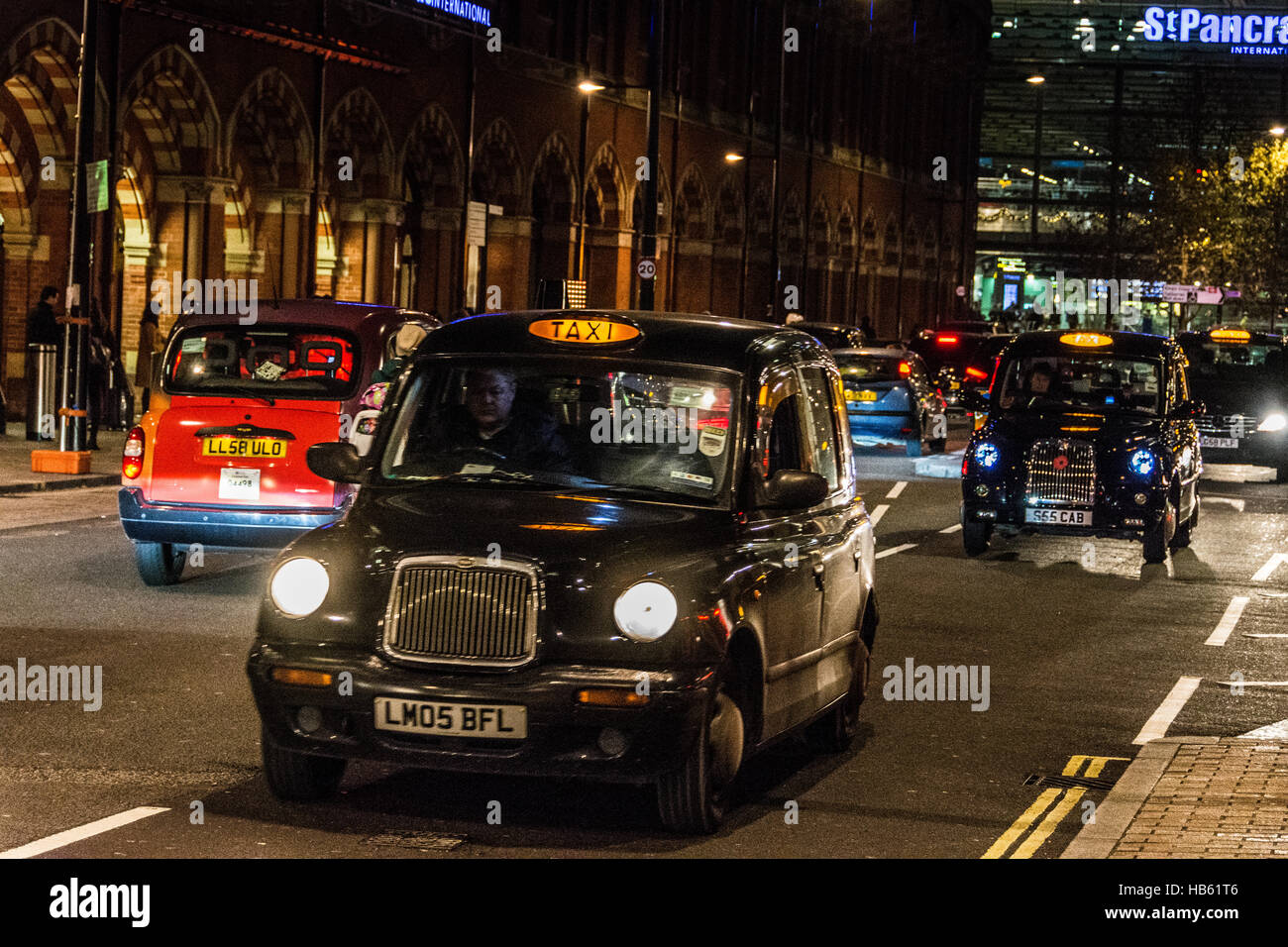 Taxis outside St. Pancras station in London, England, UK - Stock Image