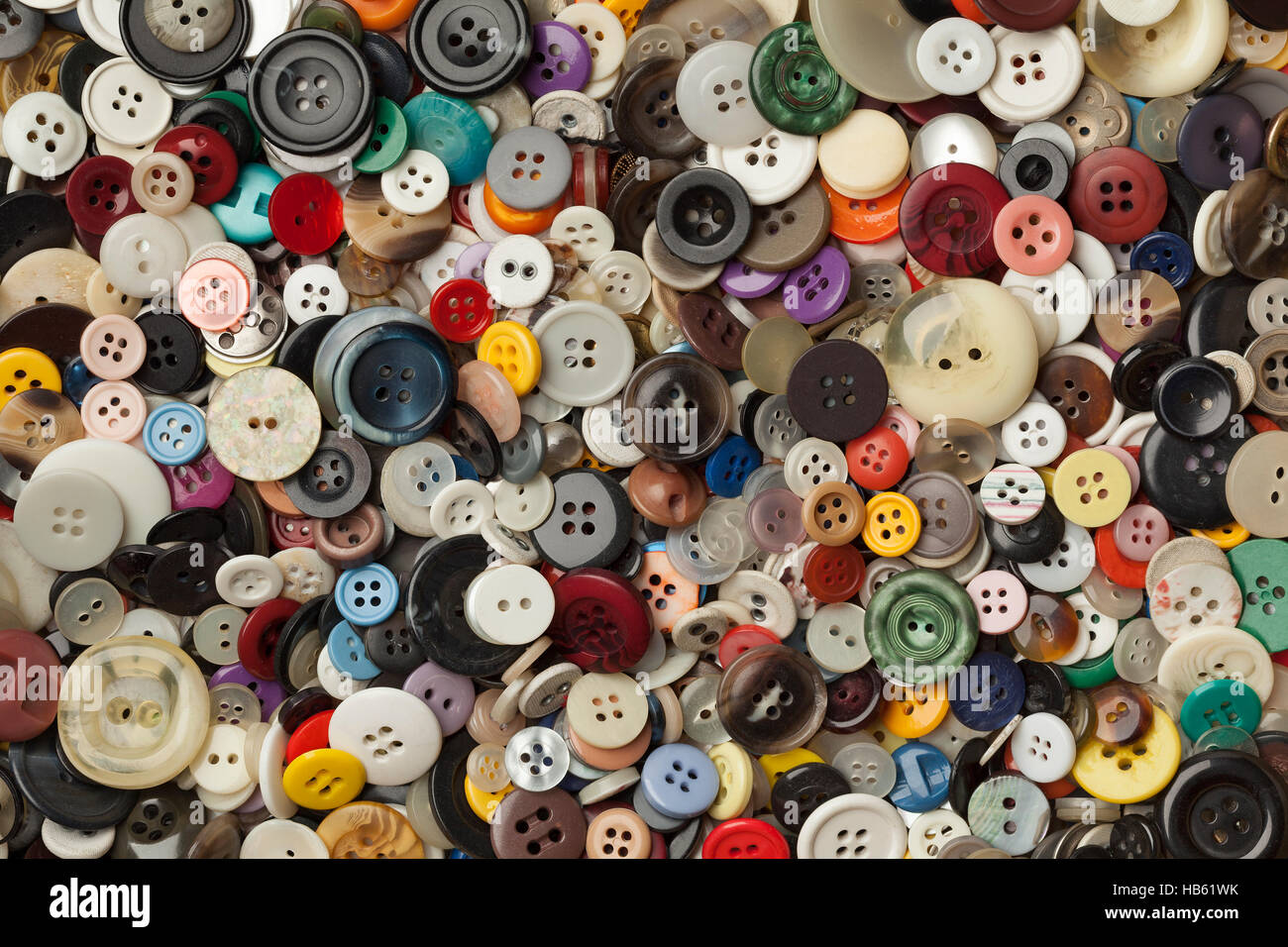 Collection of colorful sewing buttons full frame - Stock Image