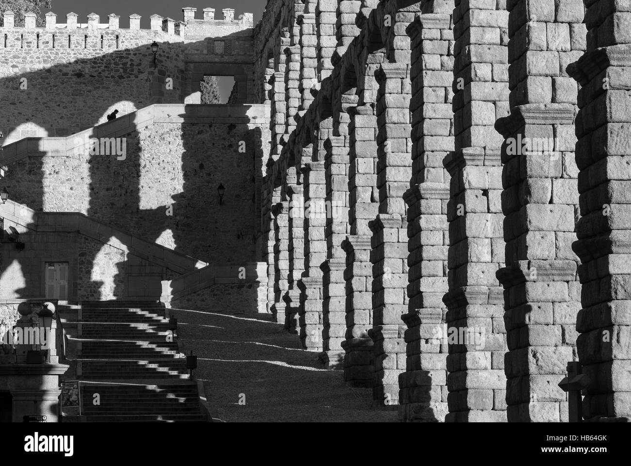 Late afternoon shadows created by Segovia's 1st century Roman Aqueduct in the Plaza Azuguejo, Segovia, Spain - Stock Image