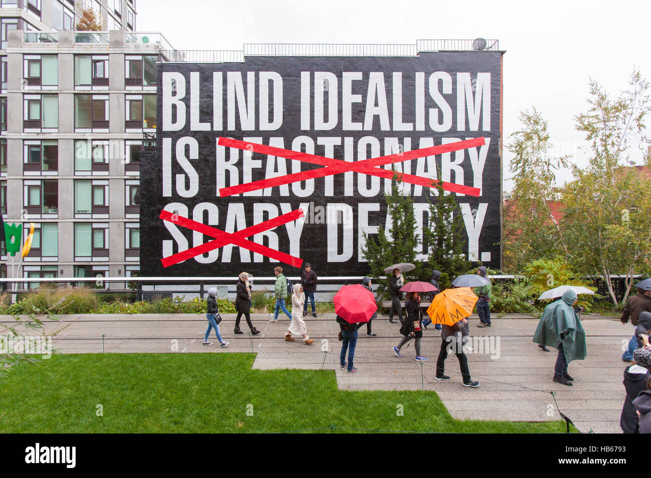 Blind idealism is Deadly by Barbara Kruger a large mural painted on the side of a building in High Line Park, New - Stock Image