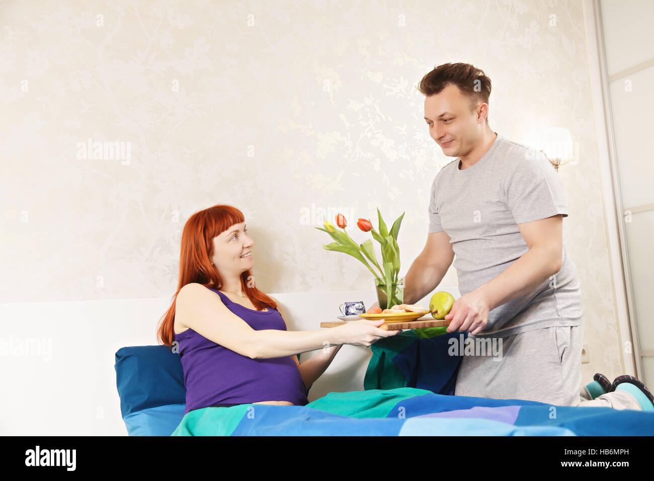 Guy serves breakfast - Stock Image